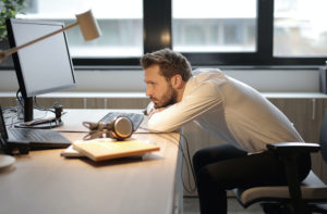 Man Leaving Over Desk, Photo by Andrea Piacquadio from Pexels